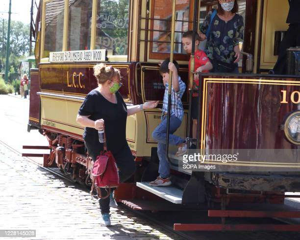 Passengers disembark a tram while wearing face masks as a preventive measure against the spread of Coronavirus . Museums re-opened in the UK with...
