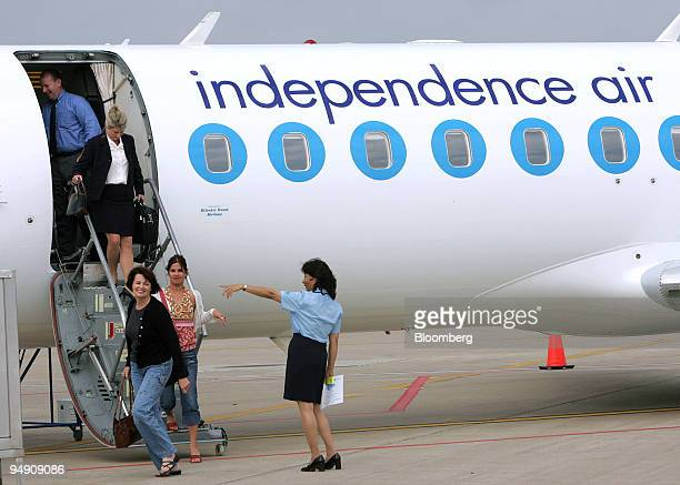 Passengers disembark an Independence Air airplane at Dulles International Airport in Virginia Wednesday June 16 2004 Independence Air a former...