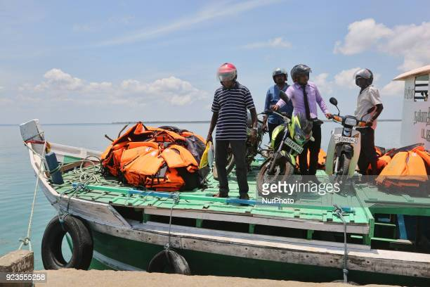 Passengers disembark from a ferry boat and unload their motorbikes on Nainativu Island in the Jaffna region of Sri Lanka