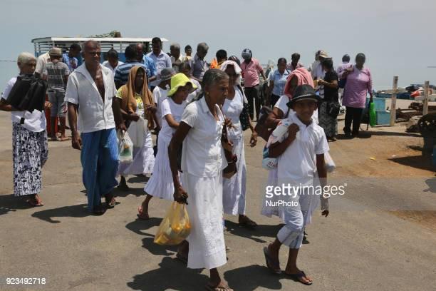 Passengers disembark from a ferry boat at Kurikadduvan Harbour in Northern Sri Lanka