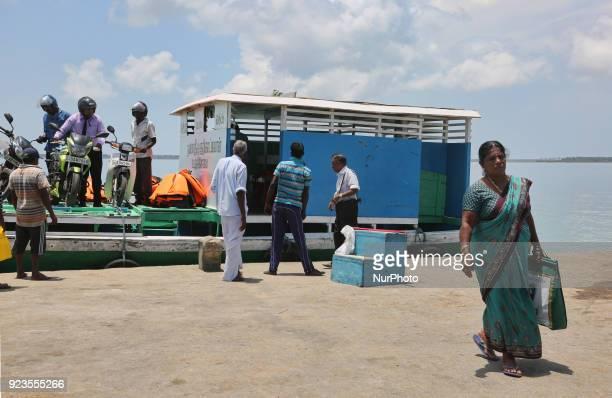 Passengers disembark from a ferry boat on Nainativu Island in the Jaffna region of Sri Lanka