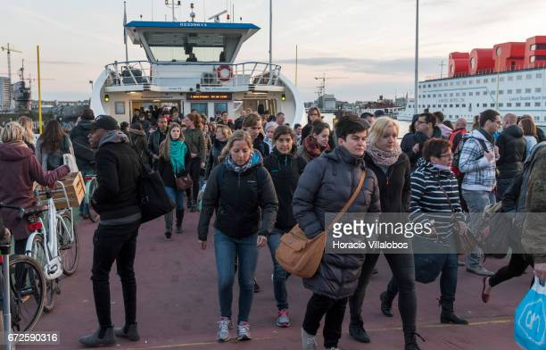 Passengers disembark from a ferry sailing from Central Station to NDSM on April 19 2017 in Amsterdam Netherlands GVB ferries crisscross the city's...