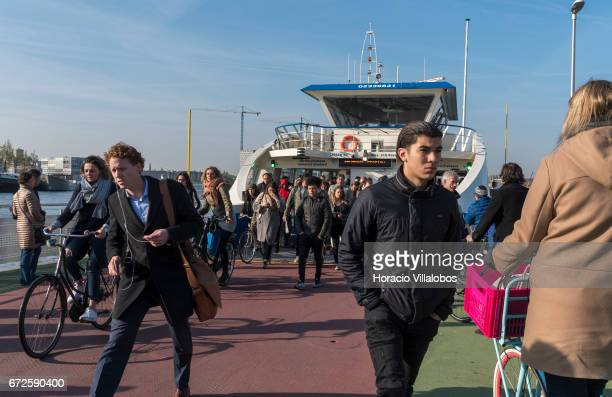 Passengers disembark from a ferry sailing from Central Station to NDSM on April 20 2017 in Amsterdam Netherlands GVB ferries crisscross the city's...