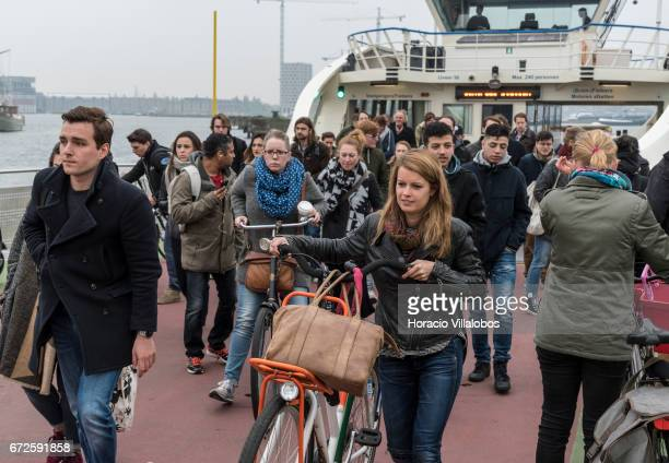 Passengers disembark from a ferry sailing from Central Station to NDSM on April 21 2017 in Amsterdam Netherlands GVB ferries crisscross the city's...