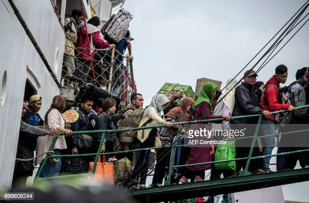 Passengers disembark from a ship at Surabaya seaport in East Java province on June 22 as part of Indonesia's mass exodus to their respective home...