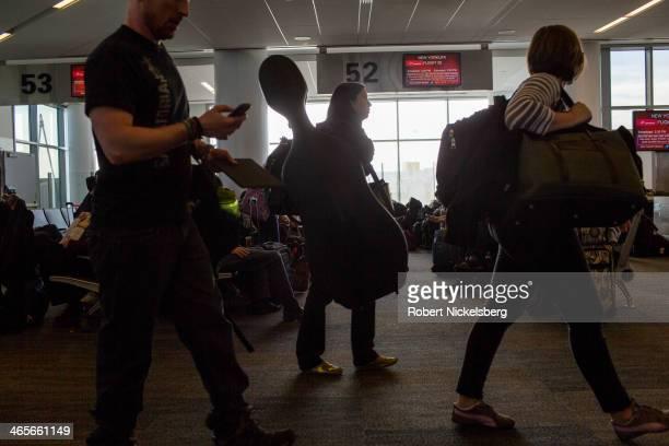 Passengers disembark from a Virgin America flight January 12 2014 in San Francisco California