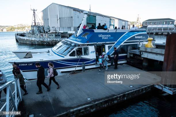 Passengers disembark from the Cobar Cat ferry at a pier in Wellington New Zealand on Wednesday July 18 2018 New Zealand inflation picked up in the...