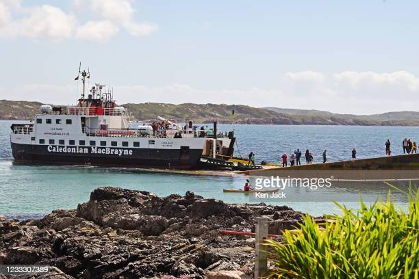 Passengers disembark from the ferry to Iona, on June 6, 2021 in Iona, Scotland. The Scottish Government has this week moved most Scottish islands...