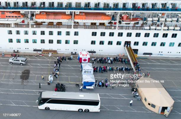 Passengers disembark from the Grand Princess cruise ship while docked at the Port of Oaklandu2019s Outer Harbor in Oakland Calif on Monday March 9...