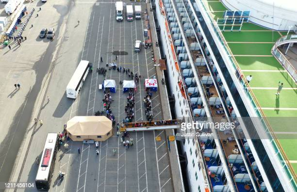 Passengers disembark from the Princess Cruises Grand Princess cruise as it sits docked in the Port of Oakland on March 09 2020 in Oakland California...