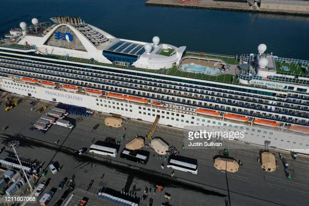 Passengers disembark from the Princess Cruises Grand Princess cruise as it sits docked in the Port of Oakland on March 10 2020 in Oakland California...