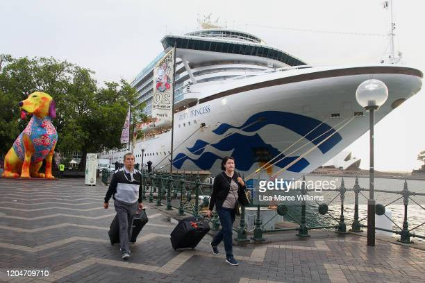 Passengers disembark from the Ruby Princess at Overseas Passenger Terminal on February 08 2020 in Sydney Australia Authorities around the world are...