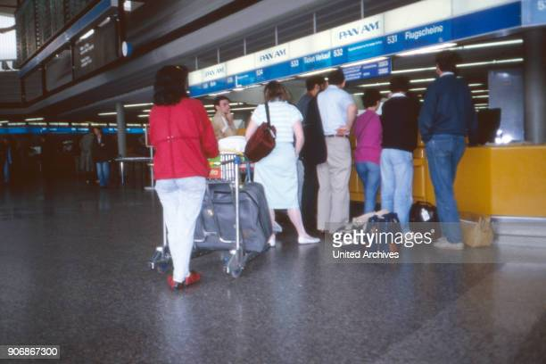 Passengers doing their check in at the Pan Am counter at Frankfurt airport Germany 1980s