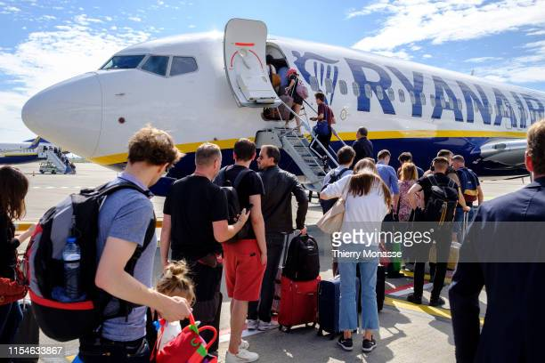 AIRPORT GOSSELIES HAINAUT BELGIUM JULY 5 2019 Passengers embark in a Boeing 7378AS in BrusselsCharleroi Airport on July 5 2019 Ryanair DAC is a...