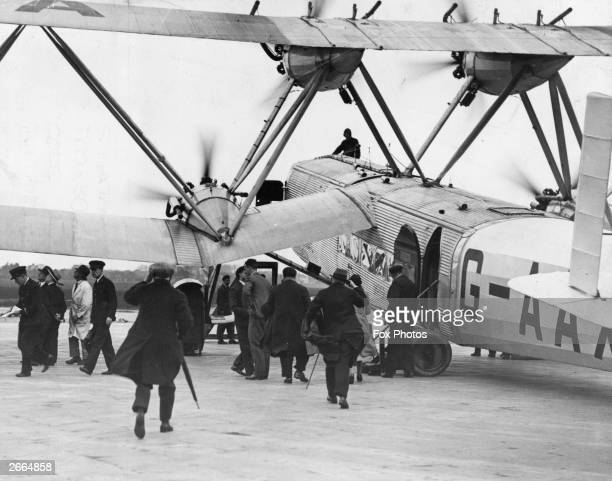 Passengers embarking a British Imperial Airways Handley Page HP42 Heracles class passenger plane.