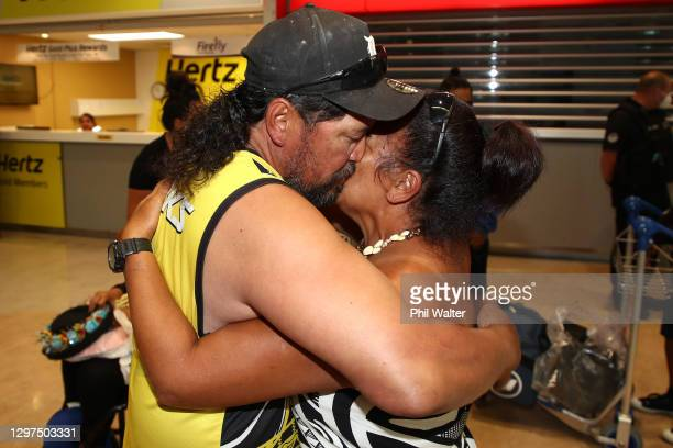 Passengers embrace after arriving from the Cook Islands on January 21, 2021 in Auckland, New Zealand. Flight NZ941 is the first quarantine-free...