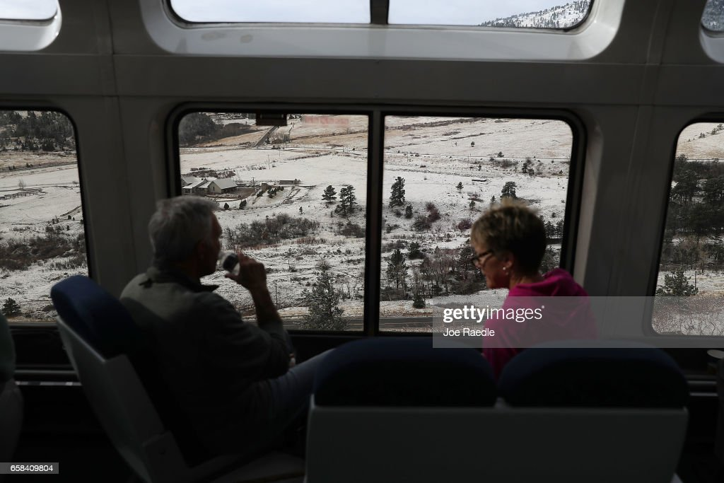 Passengers enjoy the sightseer lounge car on Amtrak's California Zephyr during its daily 2,438-mile trip to Emeryville/San Francisco from Chicago that takes roughly 52 hours on March 24, 2017 in Denver, United States. President Trump has proposed a national budget that would terminate federal support for Amtrak's long distance train services, which would affect the California Zephyr and other long distance rail lines run by Amtrak.