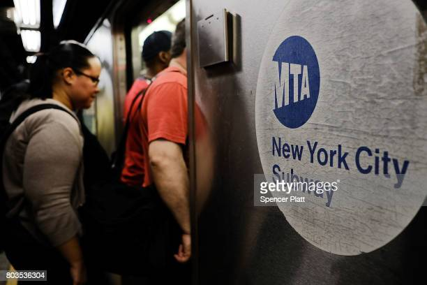 Passengers enter a Metropolitan Transportation Authority subway on June 29 2017 in New York City Following a series of breakdowns delays and...