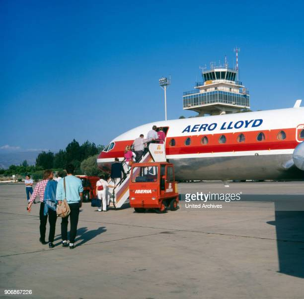 Passengers enter a plane of Aero Lloyd at Almeria airport Spain 1980s