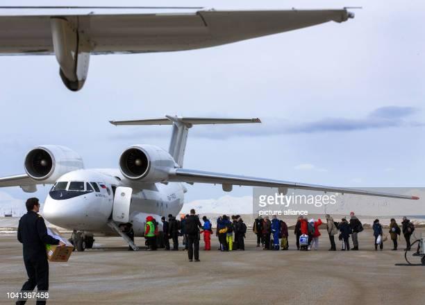 Passengers enter a Russian airplane TypeAntonov AN74 TK100 on the Svalbard Airport in Longyearbyen on Spitsbergen Norway 10 April 2015 Photo Jens...