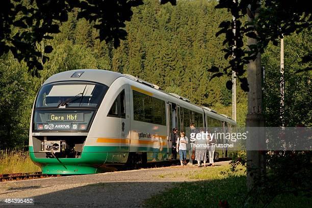Passengers enter a Train of Vogtlandbahn on July 01 2008 in Elsterberg Germany