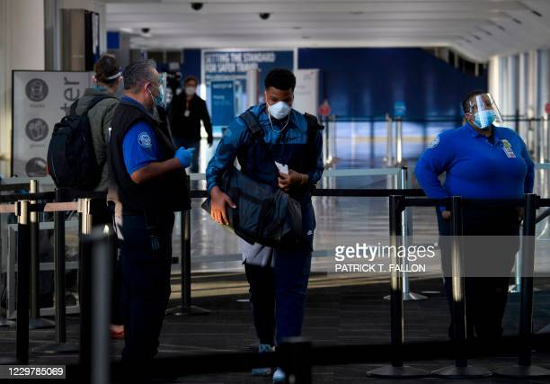 Passengers enter a Transportation Security Administration checkpoint at Los Angeles International Airport ahead of the Thanksgiving holiday in Los...