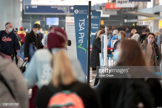 Passengers enter a Transportation Security Administration checkpoint at O'Hare International Airport on October 19, 2020 in Chicago, Illinois....