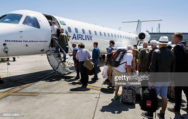 Johannesburg South Africa September 27 Passengers enter an aircraft of the South African regional airline AIRLINK at the airport of Johannesburg on...