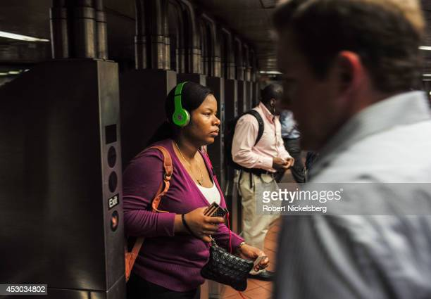 Passengers enter and exit a Metropolitan Transportation Authority subway station July 21 2014 in the Manhattan borough of New York