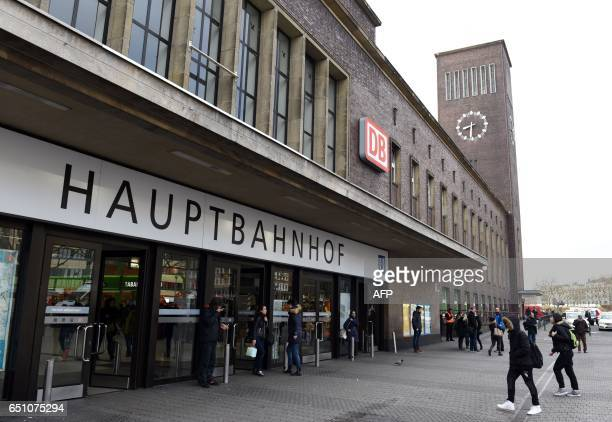 Passengers enter the main train station of Duesseldorf western Germany on March 10 one day after German police have arrested an axewielding attacker...