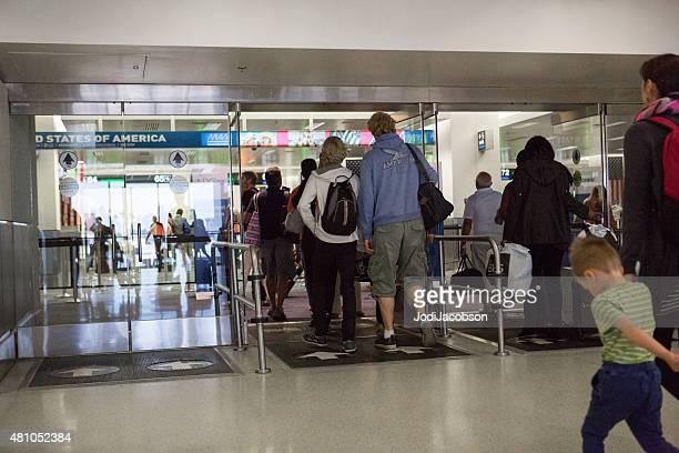 Passengers entering customs at Miami International Airport