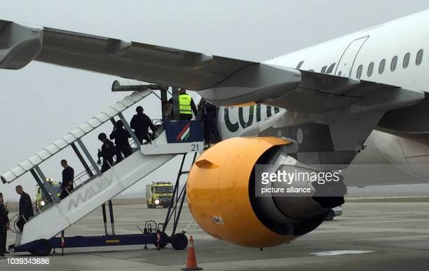 Passengers exit a Condor Machine that had to make an unscheduled landing after a bomb threat at the airport in Budapest Hungary 07 December 2015 The...