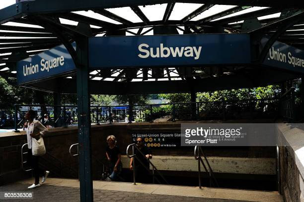 Passengers exit a Metropolitan Transportation Authority subway station on June 29 2017 in New York City Following a series of breakdowns delays and...