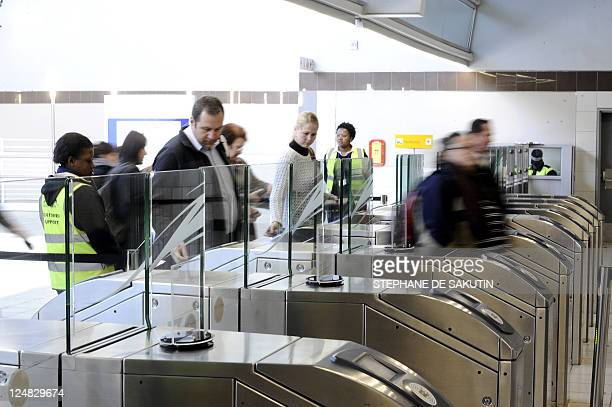 Passengers exit Sandton station in a Johannesburg suburb after riding the Gautrain Africa's first highspeed rail line on August 2 2011 South Africa's...