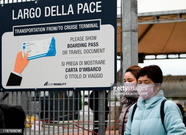 Passengers exit the port of Civitavecchia 70km north of Rome early on January 31 2020 Thousands of stranded tourists were free to disembark from a...
