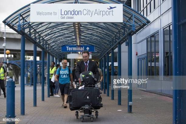 Passengers exit the terminal at London City Airport in London UK on Tuesday Aug 8 2017 The chief Brexit concern of carriers is to maintain a single...