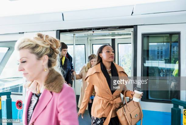passengers exiting train - disembarking stock pictures, royalty-free photos & images