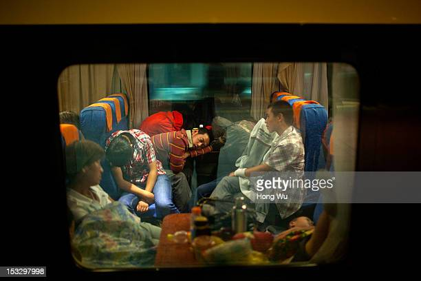 Passengers fall asleep in a train carriage of from Beijing to Lhasa on August 14 2012 in Taiyuan China After QinghaiTibet Railway went into operation...