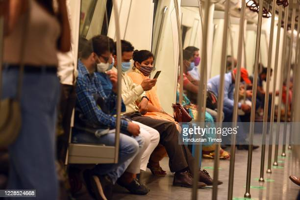 Passengers follow social distancing norms to prevent the spread of coronavirus while travelling in a metro train during Unlock 4 on September 14 2020...
