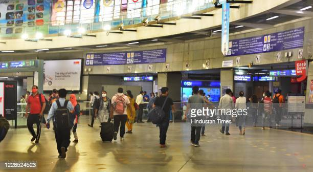 Passengers follow social distancing norms while using metro services during Unlock 4 at Rajiv Chowk metro station on September 14 2020 in New Delhi...
