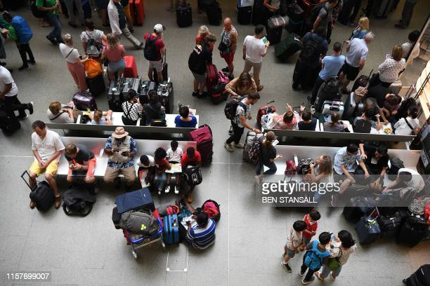 Passengers for the Eurostar wait at St Pancras international in central London after an electrical failure caused train cancellations on July 26 2019