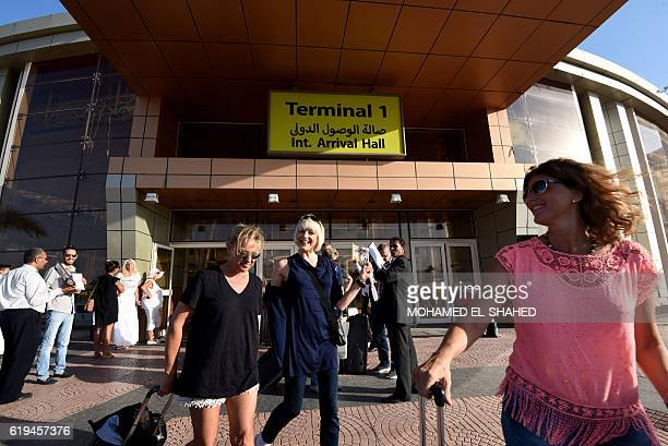Passengers from a Germania Airline flight carrying 141 German tourists leave the international airport of Egypt's Red Sea town of Sharm elSheikh upon...