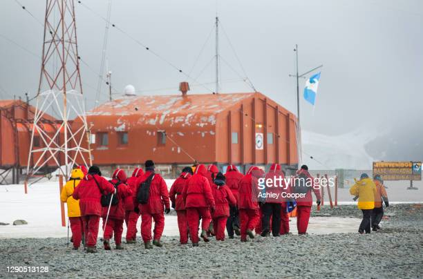 passengers from an expedition cruise visit base orcadas which is an argentine scientific station in antarctica - south orkney island stock pictures, royalty-free photos & images