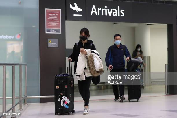 Passengers from China Southern Airlines flight CZ319 arrive at Perth International Airport on February 02, 2020 in Perth, Australia. The number of...