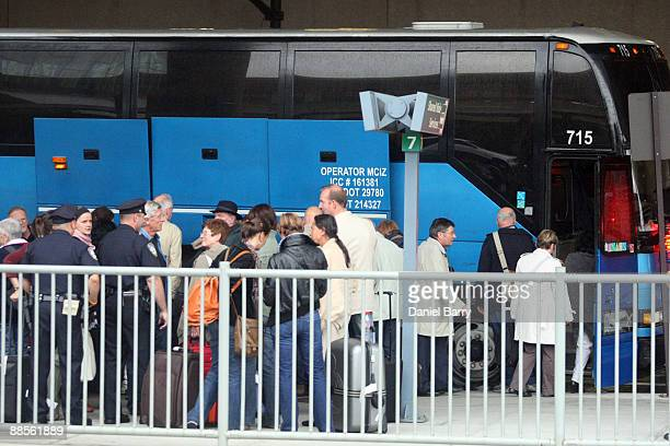 Passengers from Continental Airlines Flight 61 board a bus at Newark Liberty International Airport June 18 2009 in Newark New Jersey The flight...