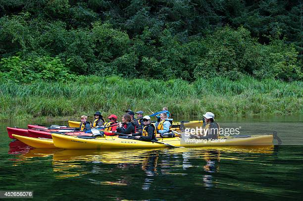 Passengers from cruise ship Safari Endeavour sea kayaking at Pavlof Harbor in Chatham Strait Chichagof Island Tongass National Forest Alaska USA