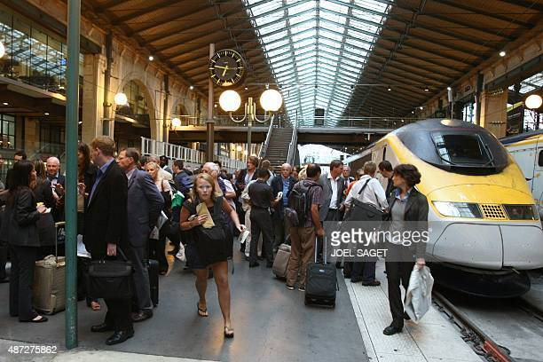 Passengers from the Eurostar blocked in the Channel Tunnel receive pieces of information as they arrive on September 11 2008 at Gare du Nord...