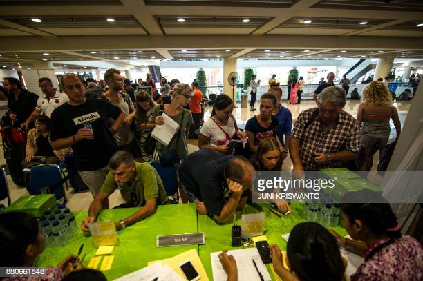 Passengers gather at the Ngurah Rai International airport in Denpasar Bali on November 28 2017 to wait for possible flights out following Mount...