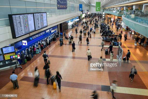 Passengers gather in the departure lobby at Haneda Airport in Tokyo Japan on Friday April 26 2019 A recordlong 10day public holiday to mark Japan's...
