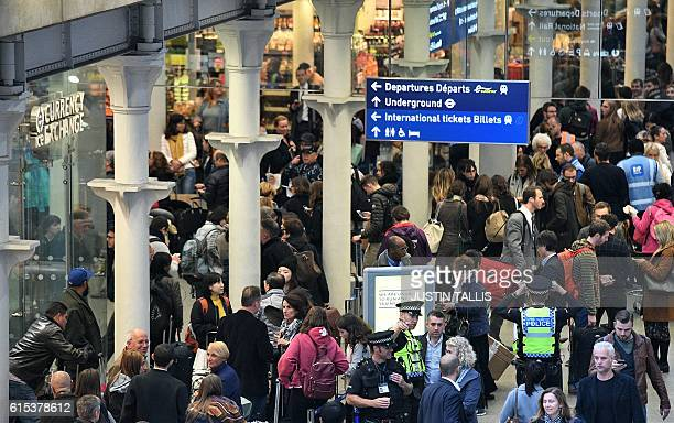 Passengers gather in the International Departures area at the Eurostar terminal at London St Pancras train station in London on October 18 2016...